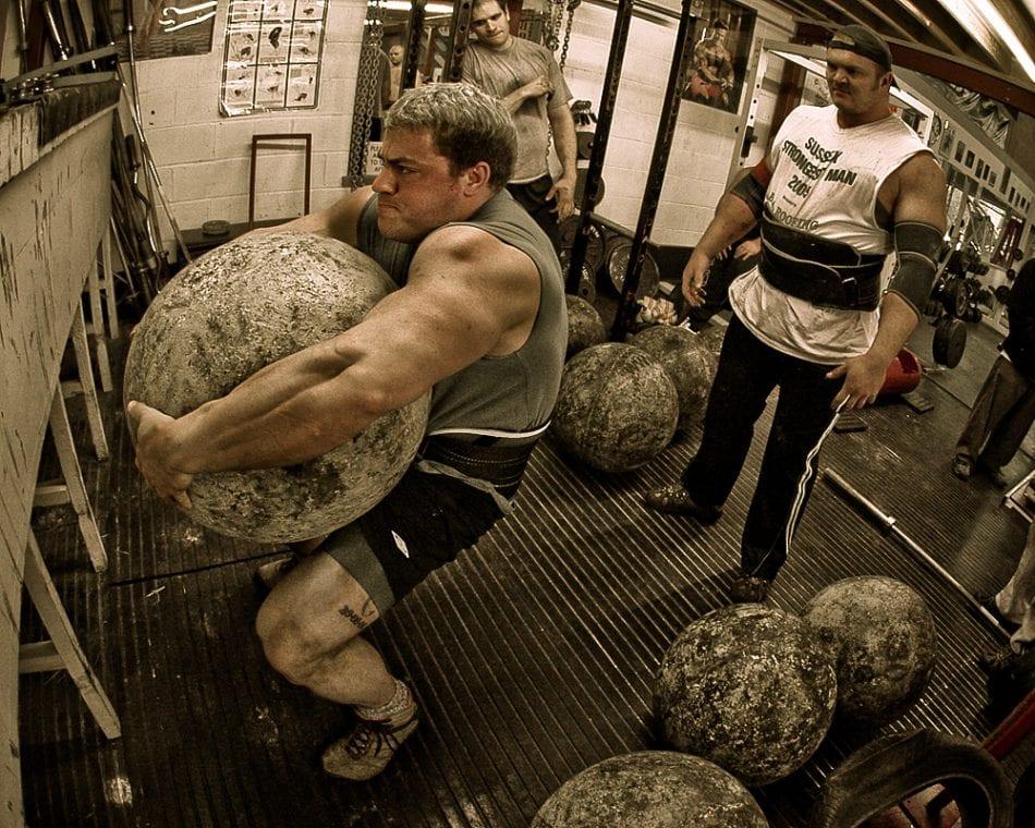 Man-Lifting-Heavy-Stone