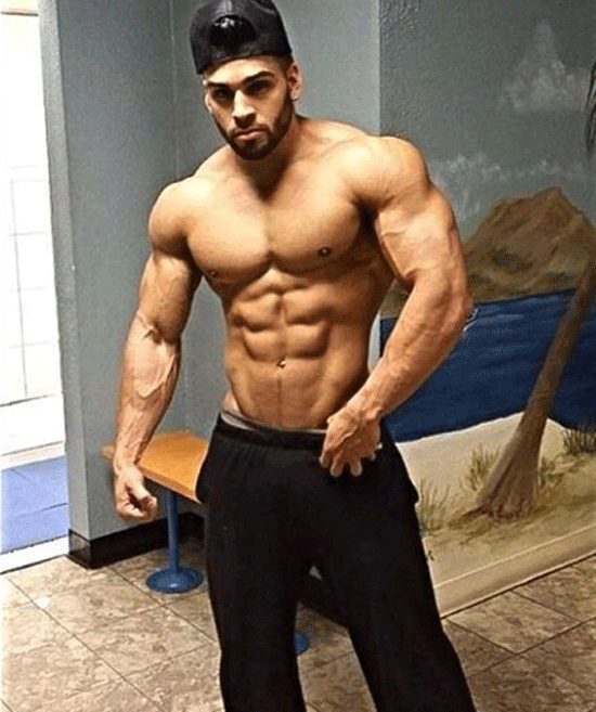 muscle guy wearing pants and cap