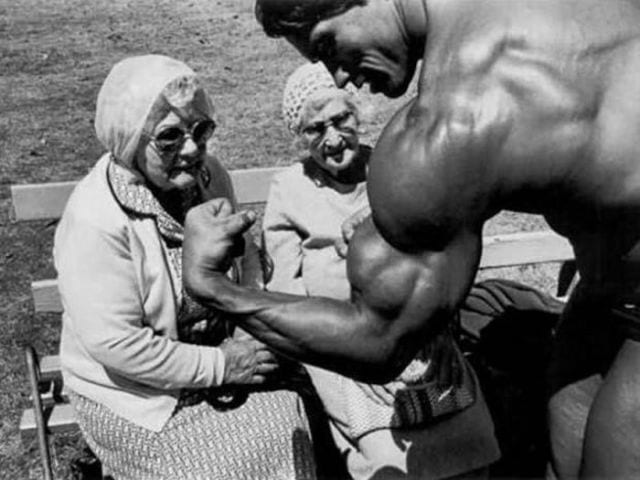 Arnold Schwarzenegger shows off to some elderly women in the 1970's