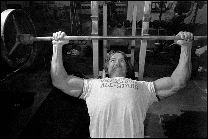 vintage photo arnold during bench press