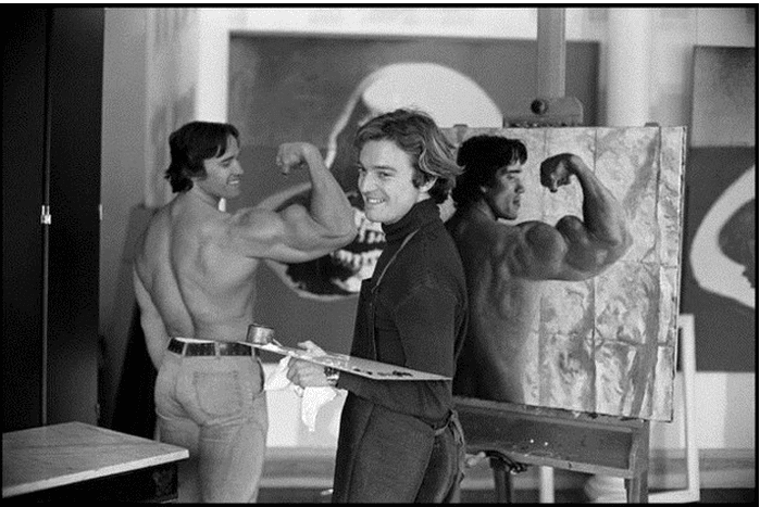 arnold posing for painter
