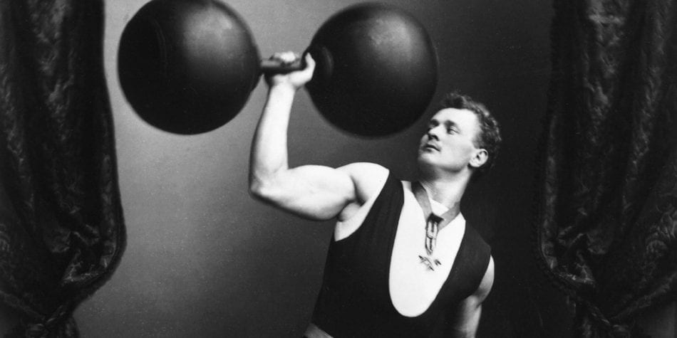 circa 1895: German strong-man Eugene Sandow (1867 - 1925) lifting weights and dumbbells. (Photo by Rischgitz/Getty Images)