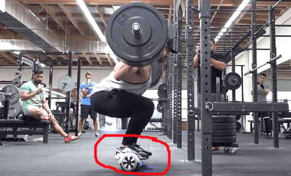 Bradley Martyn Squats 315 For Reps On A Hoverboard