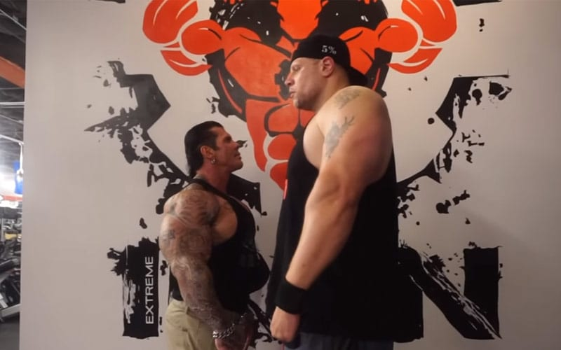 rich-piana-next-to-giant
