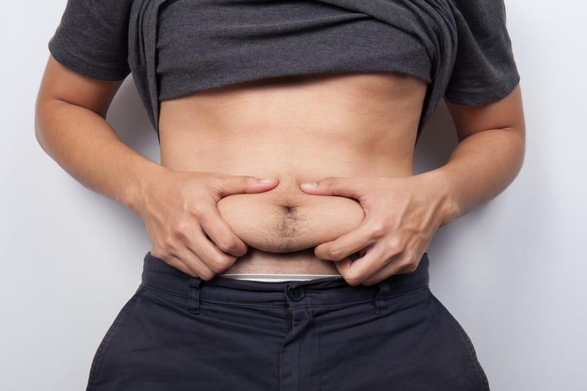 Man Pinching the Fat on his Belly
