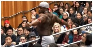 Young Bodybuilder Strips Off In Lecture Hall And Students Look In Awe