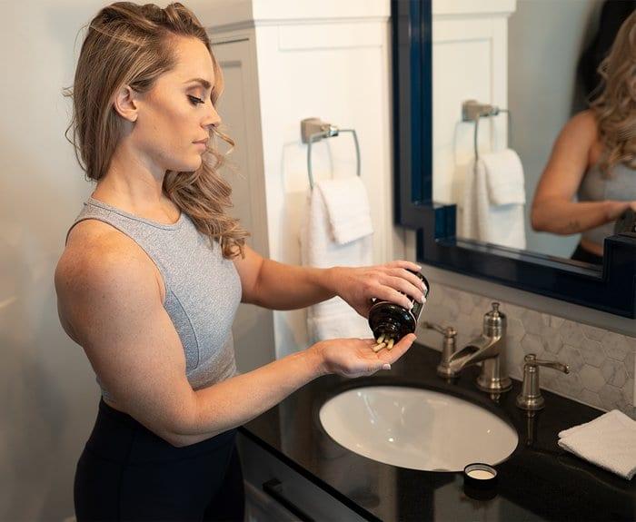 woman taking pre workout